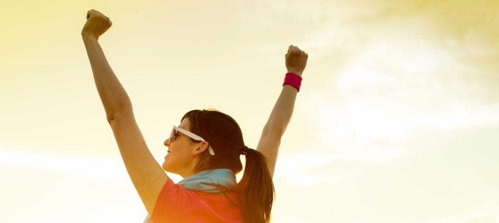 Woman with arms upraised victoriously